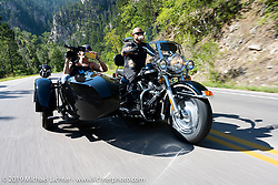 Robbin Cole shooting video from a sidecar on the Cycle Source annual ride to the hills during the Sturgis Motorcycle Rally. SD, USA. Wednesday, August 11, 2021. Photography ©2021 Michael Lichter.