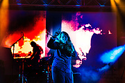 Kate Tempest performing on the Hell Stage, Shangri La field, Glastonbury Festival 2016. The Glastonbury Festival is the largest greenfield festival in the world, and is now attended by around 175,000 people. Its a five-day music festival that takes place near Pilton, Somerset, United Kingdom. In addition to contemporary music, the festival hosts dance, comedy, theatre, circus, cabaret, and other arts. Held at Worthy Farm in Pilton, leading pop and rock artists have headlined, alongside thousands of others appearing on smaller stages and performance areas.
