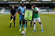Jamille Matt (14) of Forest Green Rovers presents a shirt in memory of Lee Collins before kickoff in the Pre-Season Friendly match between Yeovil Town and Forest Green Rovers at Huish Park, Yeovil, England on 31 July 2021.