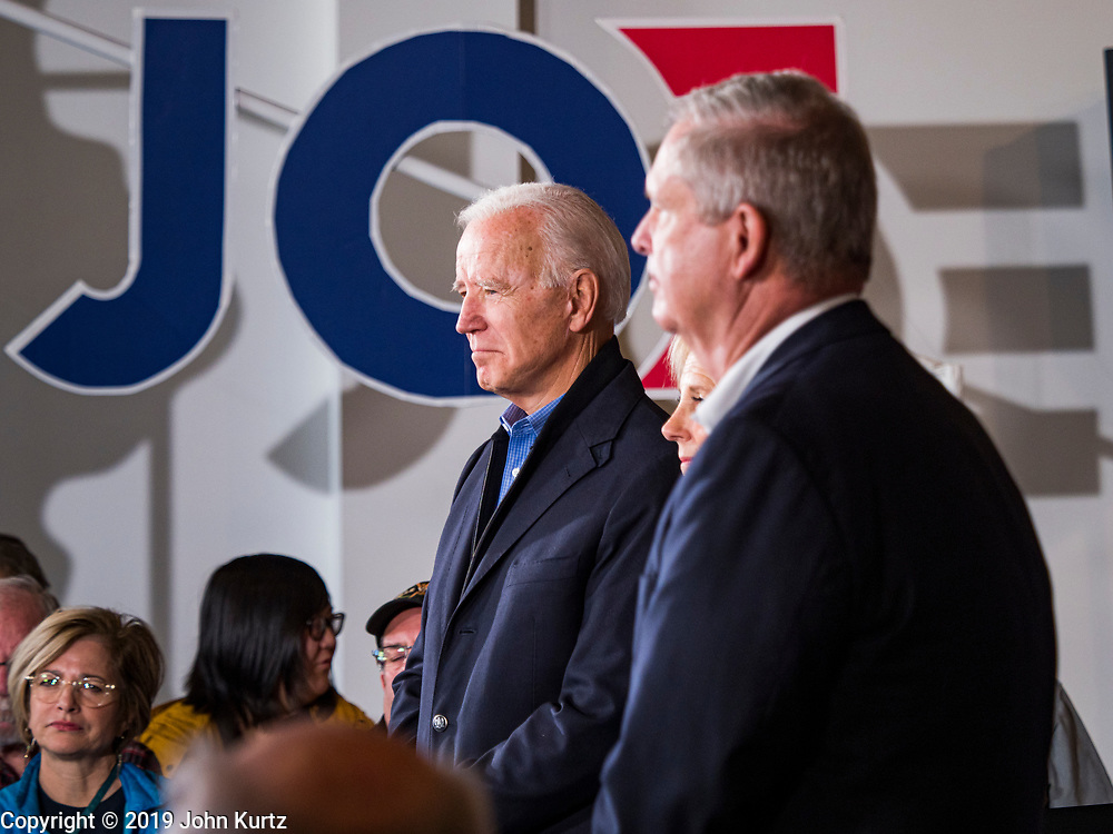 23 NOVEMBER 2019 - DES MOINES, IOWA: Joe Biden, left, waits to speak at a campaign event. Vice President Biden announced that Tom Vilsack, the former Democratic governor of Iowa, endorsed him. Biden and Vilsack appeared with their wives at an event in Des Moines. Iowa hosts the first presidential selection event of the 2020 election cycle. The Iowa caucuses are on February 3, 2020.                   PHOTO BY JACK KURTZ