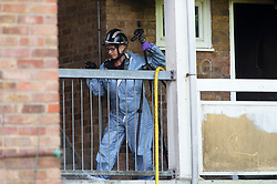 ©Licensed to London News Pictures.  20/08/2019.<br /> Orpington ,UK. A forensic officer taking pictures.  London Fire Brigade, Police and the London Ambulance Service are all in attendence this morning at a serious flat fire in Petten Grove, Orpington, South East London which has seen three people taken to hospital suffering from smoke inhalation one of the three is a child. A police cordon is in place as fire investigation officers work on scene. Photo credit: Grant Falvey/LNP