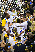 The Golden State Warriors celebrate becoming NBA Champions after beating the Cleveland Cavaliers in Game 5 of the NBA Finals at Oracle Arena in Oakland, Calif., on June 12, 2017. (Stan Olszewski/Special to S.F. Examiner)