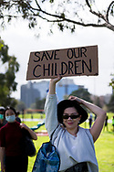 MELBOURNE, VIC - SEPTEMBER 05: A woman holds up a sign during the Anti-Lockdown Protest on September 05, 2020 in Sydney, Australia. Stage 4 restrictions are in place from 6pm on Sunday 2 August for metropolitan Melbourne. This includes a curfew from 8pm to 5am every evening. During this time people are only allowed to leave their house for work, and essential health, care or safety reasons. (Photo by Dave Hewison/Speed Media)