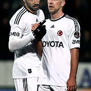 Besiktas's Hugo Almedia (L) and Fabian Ernst (R) during their Turkish Superleague soccer match Ankaragucu between Besiktas at the 19 Mayis stadium in Ankara Turkey on Sunday 08 January 2012. Photo by TURKPIX