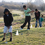 The First Tee of Monterey County opens the door to golf, as well as academic tutoring,  to many underprivileged kids of Salinas, CA, like Jose Calderon, second from left.