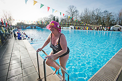 ©  London News Pictures. 26/01/2013. London, UK. A competitor leaving the water wearing a hat in the Cold Water Swimming Championships at Tooting Bec Lido in South London on January 26, 2013. The biannual event sees some competitors dress in costume. Photo credit: Ben Cawthra/LNP