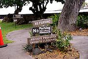 Signs announcing No Parking, No Dogs, No Bicycles, and No Skateboards. Hulihe'e Palace, Kailua-Kona, Big Island, Hawaii
