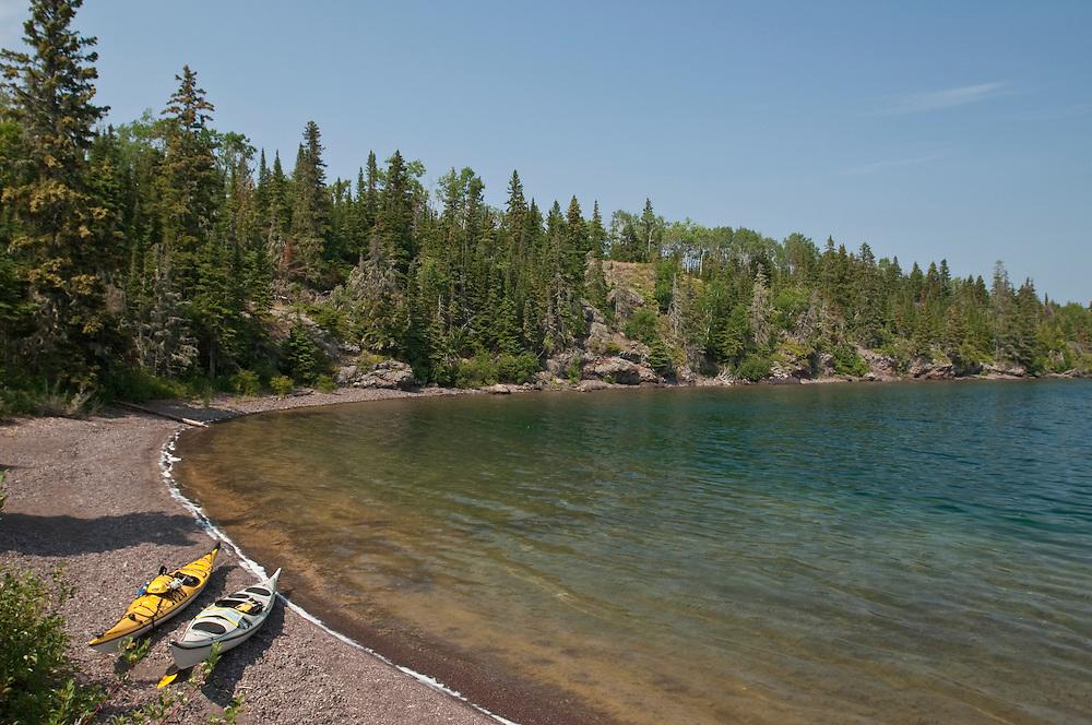 Kayaks on a gravel beach of Belle Isle on Isle Royale National Park.