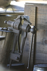 08 October 2016:   Great Smokey Mountains National Park Tools - tongs and an anvil - are shown in the blacksmith shop at Cades Cove Historic Area Visitors Center in Blount County Tennessee.  Cades Cove is within the Great Smoky Mountains National Park