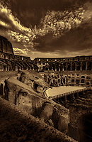 """""""A perfect evening overlooking the Colosseum - BW""""…<br /> <br /> A sunlit and pleasant view of the ancient and organic Colosseum.  The Colosseum, is an elliptical amphitheatre in the center of the city of Rome, the largest ever built during the Roman Empire. One of the greatest works of Roman architecture and engineering in history, its construction started in 72 AD under the emperor Vespasian and was completed in 80 AD under Titus. Capable of seating 65,000 spectators, it was used for gladiatorial contests and public spectacles such as mock sea battles, animal hunts, executions, re-enactments of famous battles, and dramas based on Classical mythology. The building ceased to be used for entertainment in the early medieval era. It is one of Rome's most popular tourist attractions and still has close connections with the Roman Catholic Church, as each Good Friday the Pope leads a torch lit """"Way of the Cross"""" procession that starts in the area around the Colosseum.  The Colosseum is generally regarded by Christians as a site of the martyrdom of large numbers of believers during the persecution of Christians in the Roman Empire, as evidenced by Church history and tradition.  A Cross stands exultant in the Colosseum center with a plaque stating:  """"The amphitheatre, one consecrated to triumphs, entertainments, and the impious worship of pagan gods, is now dedicated to the sufferings of the martyrs purified from impious superstitions.""""  In viewing many historical sites during my journey in Italy, seeing the iconic Colosseum for the first time…I became awestruck.   It is as grand in person as it appears in the media, and it seems to hold a very mystical aura.  Climbing the ancient steps inside, one cannot help but feel not only the suffering of its past, but the forgiveness and sacrifice of its present stature.  I created this image in the late evening as the guards ushered me out for closing time."""