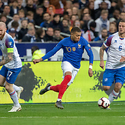 PARIS, FRANCE - March 25:  Kylian Mbappé #10 of France defended by Aron Gunnarsson #17 of Iceland and Ragnar Sigurdsson #6 of Iceland during the France V Iceland, 2020 European Championship Qualifying, Group Stage at  Stade de France on March 25th 2019 in Paris, France (Photo by Tim Clayton/Corbis via Getty Images)