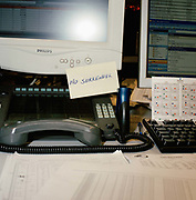 Desk at a commodity and futures brokers firm in London. From the series Desk Job, a project which explores globalisation through office life around the World.