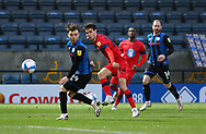 Wigan Athletic midfielder Alex Perry (24) shoots at goal under the challenge of Ollie Rathbone of Rochdale (14)  during the EFL Sky Bet League 1 match between Rochdale and Wigan Athletic at the Crown Oil Arena, Rochdale, England on 16 January 2021.