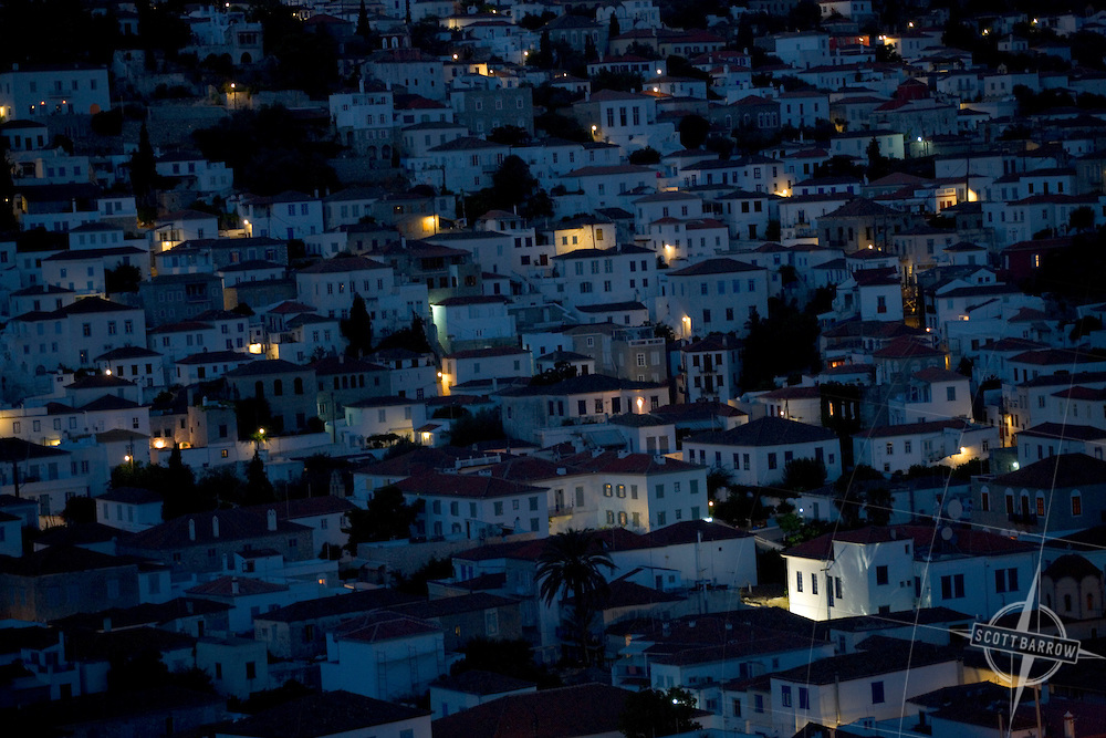 View from above of the town at night on Hydra, Greece.
