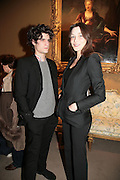 Louis Garel and Carla Bruni, private view of The Alberto Bruni Tedeschi Collection -  Sotheby's,19 March 2007.  -DO NOT ARCHIVE-© Copyright Photograph by Dafydd Jones. 248 Clapham Rd. London SW9 0PZ. Tel 0207 820 0771. www.dafjones.com.