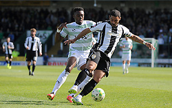Hayden Mullins of Notts County is tackled by Yeovil Town's Gozie Ugwu - Photo mandatory by-line: Harry Trump/JMP - Mobile: 07966 386802 - 11/04/15 - SPORT - FOOTBALL - Sky Bet League One - Yeovil Town v Notts County - Huish Park, Yeovil, England.