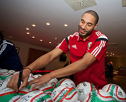 CARDIFF, WALES - Tuesday, March 4, 2014: Wales' captain Ashley Williams sign footballs during a signing session at the St. David's Hotel ahead of the International Friendly against Iceland. (Pic by David Rawcliffe/Propaganda)  CARDIFF, WALES - Tuesday, March 4, 2014: Wales' xxxx during a training session at the Cardiff City Stadium ahead of the International Friendly against Iceland. (Pic by David Rawcliffe/Propaganda)
