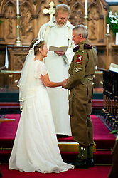 1940's Wedding Lytham The Bride Kath Plummer and groom Andy Hacking at Saint John The Divine Church Lytham with Reverend Jack Wixon.19 August 2011  Image © Paul David Drabble