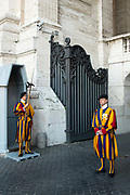 Guards in traditonal dress outside St Peters Basilica, Vatican, Rome, Italy.