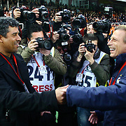 Galatasaray's coach Frank RIJKAARD (L) and Fenerbahce's coach Christoph DAUM (R) during their Turkish superleague soccer derby match Galatasaray between Fenerbahce at the AliSamiYen Stadium at Mecidiyekoy in Istanbul Turkey on Sunday, 28 March 2010. Photo by TURKPIX
