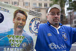 © licensed to London News Pictures. London, UK 09/07/2012. A fan waits John Terry outside Westminster Magistrates Court this morning. Photo credit: Tolga Akmen/LNP