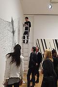 KOHEI NAWA;  ARTIST BEHIND ON STEPLADDER, Kohei Nawa: Force - private view, PACE GALLERY, Burlington House, London. 8 September 2015.