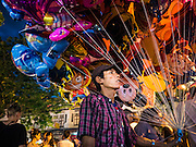 24 NOVEMBER 2015 - BANGKOK, THAILAND: An inflatable toy vendor at the Wat Saket temple fair. Wat Saket is on a man-made hill in the historic section of Bangkok. The temple has golden spire that is 260 feet high which was the highest point in Bangkok for more than 100 years. The temple construction began in the 1800s in the reign of King Rama III and was completed in the reign of King Rama IV. The annual temple fair is held on the 12th lunar month, for nine days around the November full moon. During the fair a red cloth (reminiscent of a monk's robe) is placed around the Golden Mount while the temple grounds hosts Thai traditional theatre, food stalls and traditional shows.       PHOTO BY JACK KURTZ
