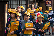 """Japenese students explore the Old Town streets of Takayama. The city of Takayama (""""tall mountain"""") lies in the heart of the Japan Alps, in the Hida region of Gifu Prefecture. Commonly differentiated as Hida-Takayama, city has the largest geographic area of any municipality in Japan."""