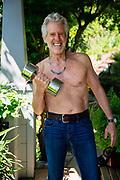 Senior Man Lifting A Weight Shirtless