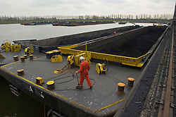 Coal is unloaded from barges at the Essent Energie power station, in Geertruidenberg, Netherlands, on Monday March 22, 2010. Essent Energie is owned by RWE AG. (Photo © Jock Fistick)