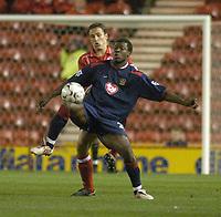 Photo. Glyn Thomas.<br /> Middlesbrough v Portsmouth. FA Barclaycard Premiership.<br /> Riverside Stadium, Middlesbrough. 06/12/2003.<br /> Portsmouth's Yakubu Ayegebni (R) shields the ball from Franck Queudrue.