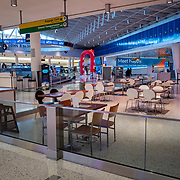 Restaurants remain empty at JFK International Airport during the holiday season with the Coronavirus (Covid-19) outbreak in Queens, New York on Tuesday, December 8, 2020. (Alex Menendez via AP)