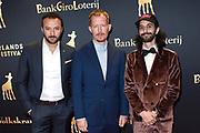 Openingsavond van het Nederlands Film Festival met de premiere van Niemand in de stad.<br /> <br /> Op de foto:  Nasrdin Dchar , Robert de Hoog , Achmed Akkabi