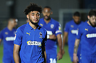 AFC Wimbledon midfielder Tyler Burey (32) walking off the pitch with team mates during the EFL Trophy group stage match between AFC Wimbledon and Stevenage at the Cherry Red Records Stadium, Kingston, England on 6 November 2018.