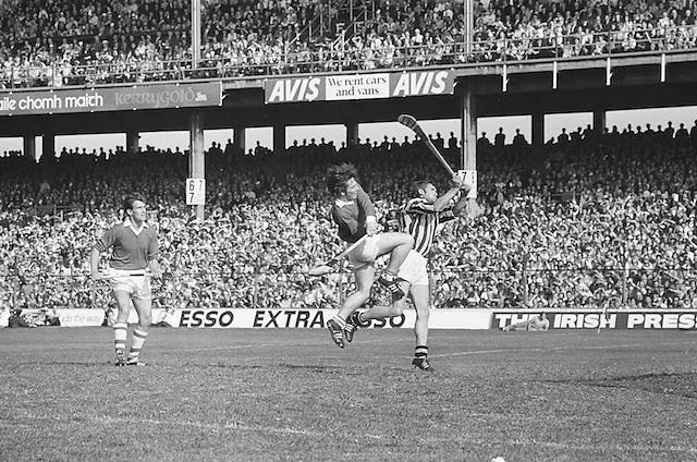 Cork and Kilkenny player try to hit the slitor mid air during at the All Ireland Senior Hurling Final, Cork v Kilkenny in Croke Park on the 3rd September 1972. Kilkenny 3-24, Cork 5-11.