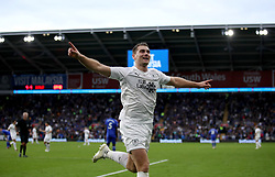 Burnley's Sam Vokes celebrates scoring his side's second goal of the game during the Premier League match at the Cardiff City Stadium.