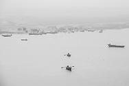 Boats heading to a ceremony on the River Ganges, Varanasi, Uttar Pradesh, India
