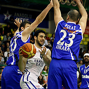 Anadolu Efes's Dogus Balbay (C) during their Turkish Basketball League match Anadolu Efes between Turk Telekom at the Ayhan Sahenk Erdem Arena in Istanbul, Turkey on Sunday, 09 March, 2013. Photo by Aykut AKICI/TURKPIX