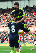 Olivier Giroud of Arsenal celebrates with teammate Aaron Ramsey after he scores his teams 4th goal. Premier league match, Stoke City v Arsenal at the Bet365 Stadium in Stoke on Trent, Staffs on Saturday 13th May 2017.<br /> pic by Bradley Collyer, Andrew Orchard sports photography.