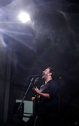 28 April 2013. New Orleans, Louisiana,  USA. .Dave Matthews of The Dave Matthews Band plays through the rain to an adoring crowd at The New Orleans Jazz and Heritage Festival..Photo; Charlie Varley.