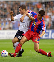 Photo: Daniel Hambury.<br />Luton Town v Crystal Palace. Coca Cola Championship. 09/09/2006.<br />Luton's Lewis Emanuel and Palace's Danny Butterfield battle.