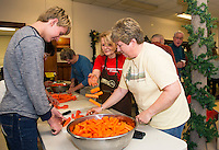 Volunteers Aaron Allen, Luann Mussari, Marilyn Lynch, Sandy Brallier and Ila Mattila peel and cut carrots in preparation for the Hazel Duke Thanksgiving Day dinner at the Laconia Congregational Church on Wednesday morning.  (Karen Bobotas/for the Laconia Daily Sun)