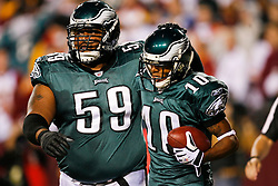Philadelphia Eagles center Nick Cole #59 congratulates Philadelphia Eagles wide receiver DeSean Jackson #10 after Jackson scored a touchdown during the NFL game between the Philadelphia Eagles and the Washington Redskins on October 26th 2009. The Eagles won 27-17 at FedEx Field in Landover, Maryland. (Photo By Brian Garfinkel)