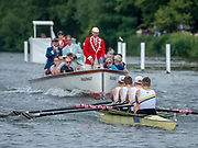 Henley Royal Regatta, 3-7 July 2019. Claires Court School, followed by the Umpire's Launch, in the Semi-Final, of the Fawley Challenge Cup, in the Launch, Umpire, Richard PHELPS, centre, with Prime Minister, P.M. Theresa MAY, to the Right. Royal Henley Peace Regatta Centenary, 1919-2019. Henley on Thames.<br /> <br /> <br /> <br /> [Mandatory Credit: Patrick WHITE/Intersport Images], 6, 06/07/2019,  14:56:29