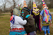 Costumed revelers dance during the Faquetigue Courir de Mardi Gras chicken run on Fat Tuesday February 17, 2015 in Eunice, Louisiana. The traditional Cajun Mardi Gras involves costumed revelers competing to catch a live chicken as they move from house to house throughout the rural community.