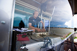 Sailing commentator Peter Montgomery in his commentary booth during qualifying session 3 Monsoon Cup 2010. World Match Racing Tour, Kuala Terengganu, Malaysia. 3 December 2010. Photo: Subzero Images/WMRT