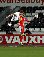 Pictured L-R: Franz Schiemer of Austria heads the ball off target, challenged by Christopher Gunter of Wales. Wednesday 06 February 2013..Re: Vauxhall International Friendly, Wales v Austria at the Liberty Stadium, Swansea, south Wales.
