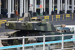 London, UK. 6th September, 2021. An armed military vehicle is pictured on a trailer in a holding area outside ExCeL London as preparations for the DSEI 2021 arms fair take place. The first day of week-long Stop The Arms Fair protests outside the venue for one of the world's largest arms fairs was hosted by activists calling for a ban on UK arms exports to Israel.