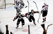 Tri-City's Brooks Macek, left, and Brendan Shinnimin celebrate teammate Kruise Reddick's game-winning overtime goal during the Americans' 4-3 win over the Rockets at the Toyota Center in Kennewick on April 9, 2010.