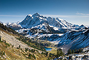 From the Chain Lakes Loop trail at Herman Saddle in Mount Baker Wilderness, view Mount Shuksan (9127 feet elevation), located in North Cascades National Park, Washington, USA.